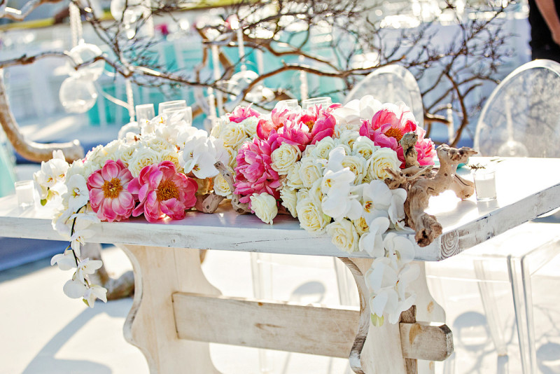 Coral peonies, white roses, white phalaenopsis orchids, manzanita branches, aqua blue linens, outdoor weddings mexico