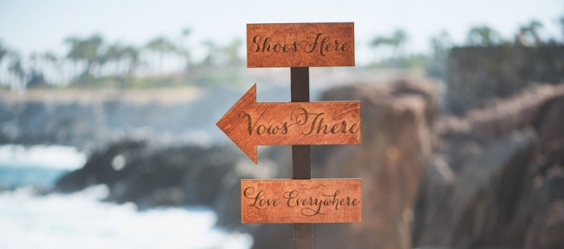 Wedding signs on the beach los cabos mexico