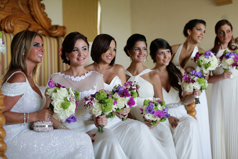 bridesmaids wearing white dresses blue green and purple bridal bouquets elena damy