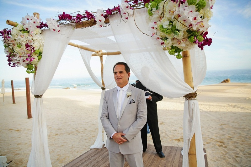 groom under chupppah tropical beach weddings elena damy