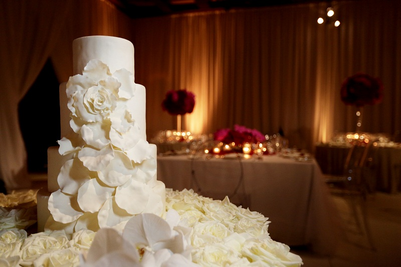 stacked white wedding cakes one & only palmilla resort elena damy floral design
