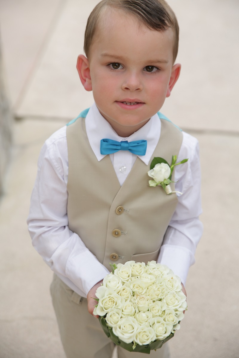 ringbearer with white flower ring box elena damy floral design mexico