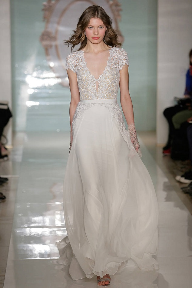 Reem Acra's elegant lace capped gown is a beach beauty.