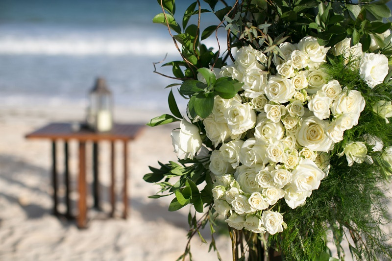 white floral ceremony structure mayan riviera weddings