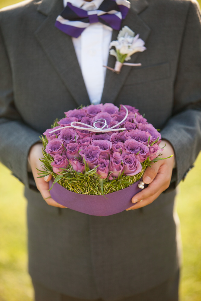 purple ring bearer boutonniere fresh rosemary and roses