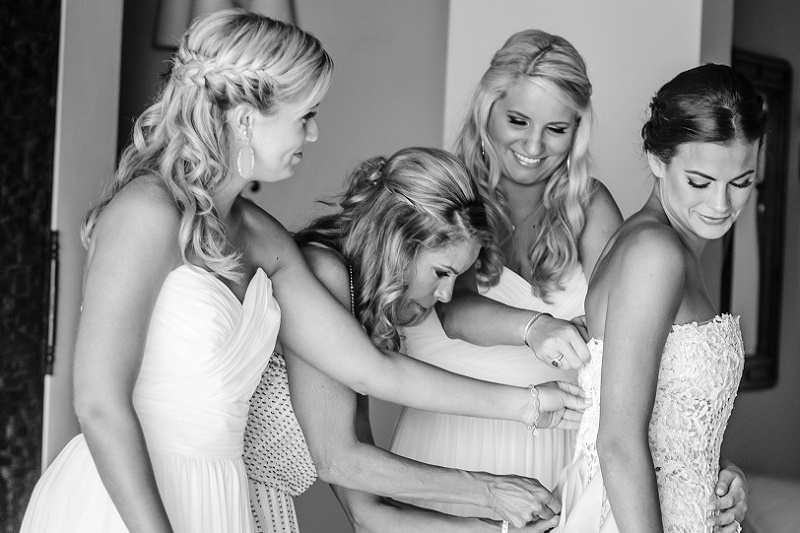 bride dressing with bridesmaids blue wedding gown