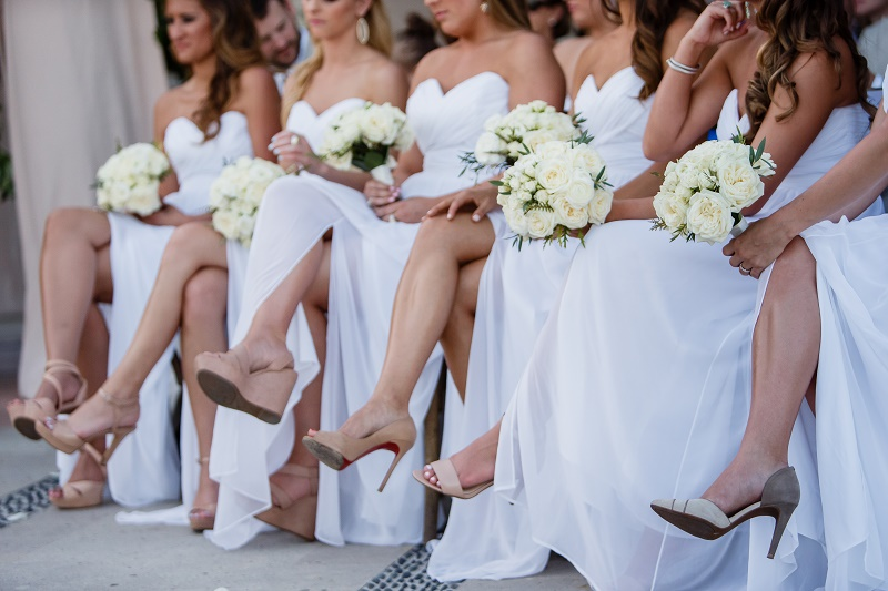 bridesmaids shoes seated during wedding ceremony white bouquets elena damy