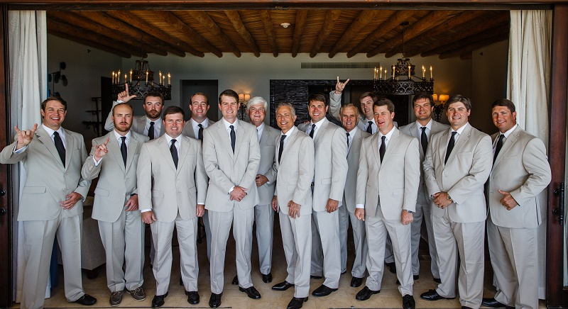 groom and his groomsmen in suits beach destination weddings mexico