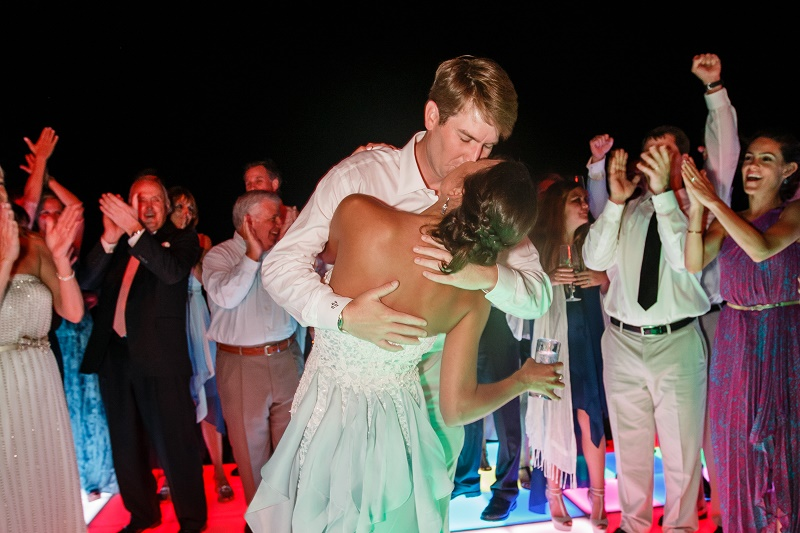 bride and groom kiss dance floor destination weddings mexico elena damy