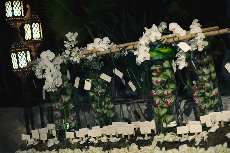 tropical place card table with orchids and floating flowers elena damy los cabos mexico