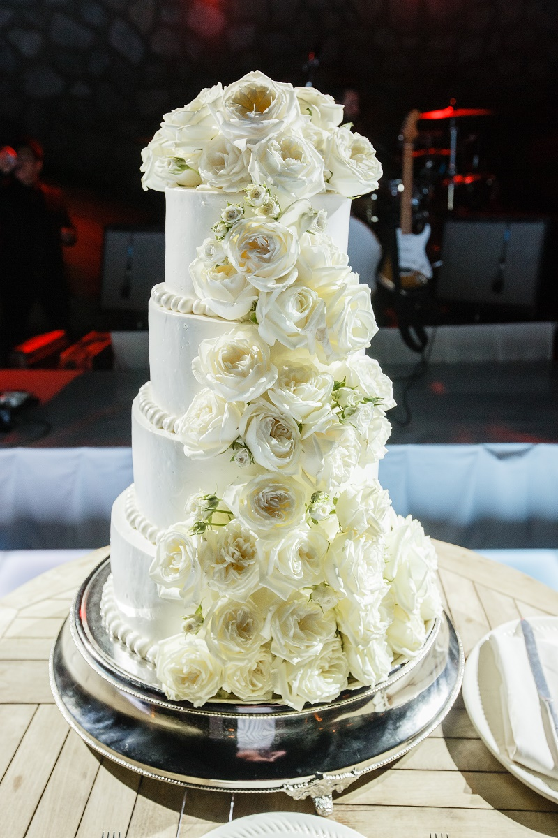 white wedding cake with fresh flowers mexico destination weddings elena damy