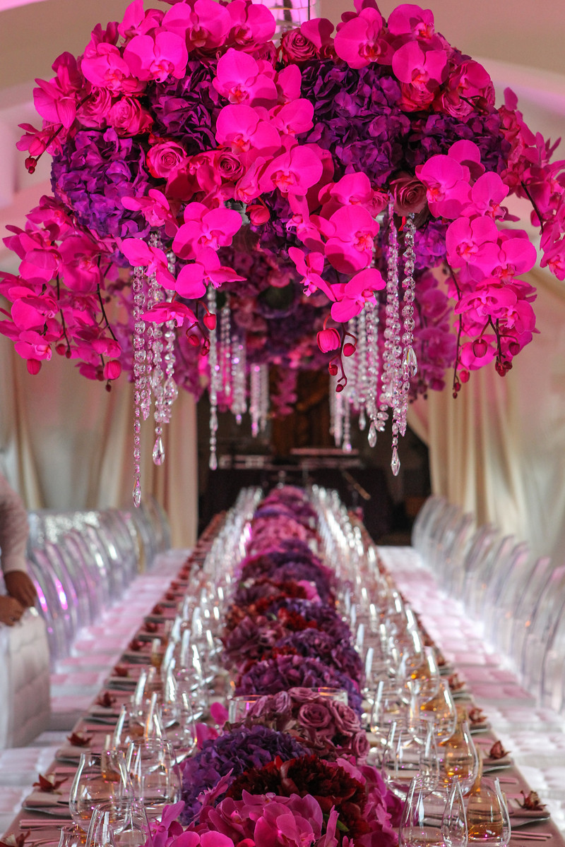 hanging orchid centerpiece long feast style table for events elena damy floral design