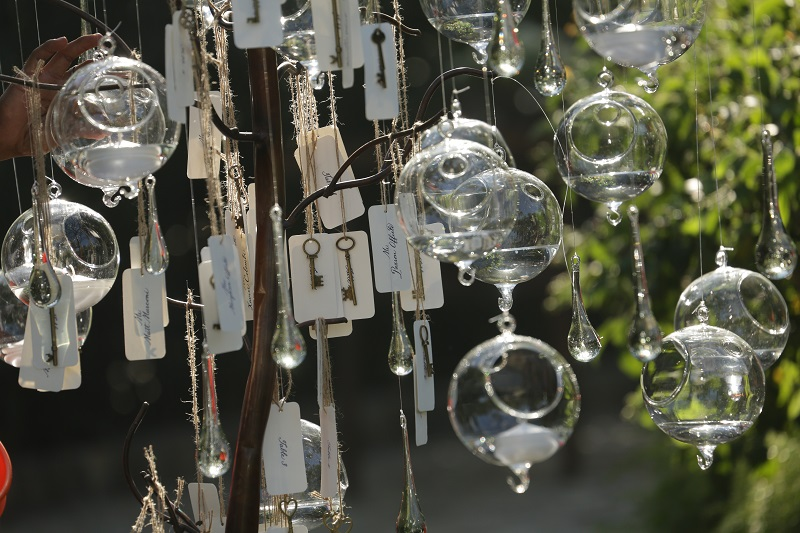 Hanging Glass Spheres with Candles and Placecards Beach Weddings Elena Damy Mexico