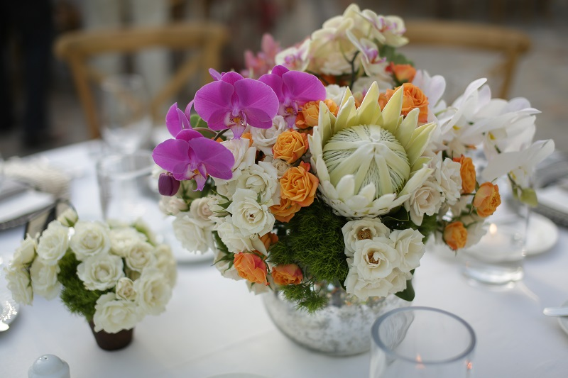 White Protea Purple Orchids Orange Roses Mercury Glass Centerpieces for Outdoor Weddings Elena Damy Floral Design Mexico