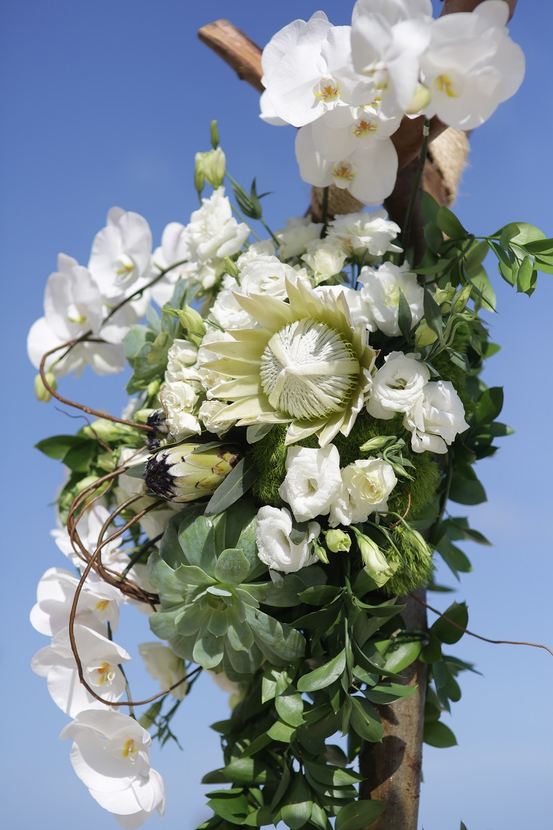 White wedding flowers for ceremony arch cabo san lucas florists elena damy