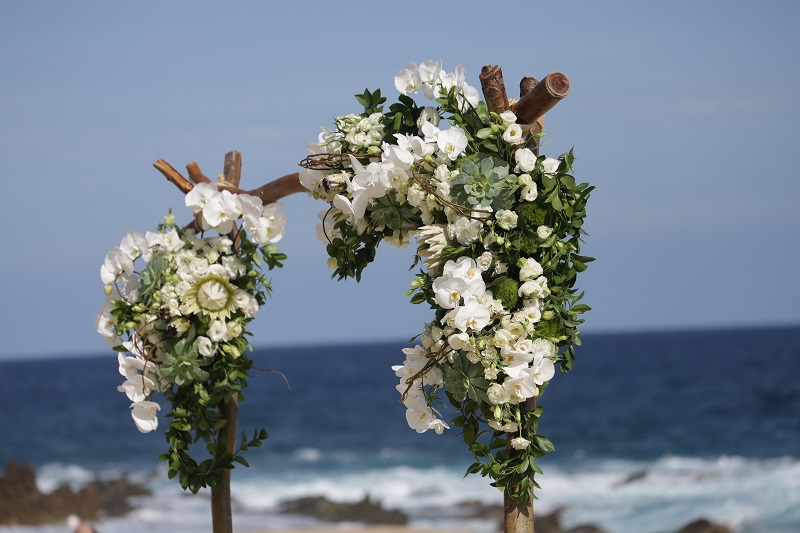 Wooden Ceremony Arch with Tropical Flowers for Beach Weddings Elena Damy Mexico Florists