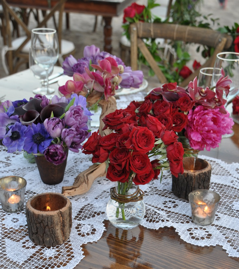 red and purple flowers beach weddings mexico elena damy floral design los cabos wooden tables lace linens 12