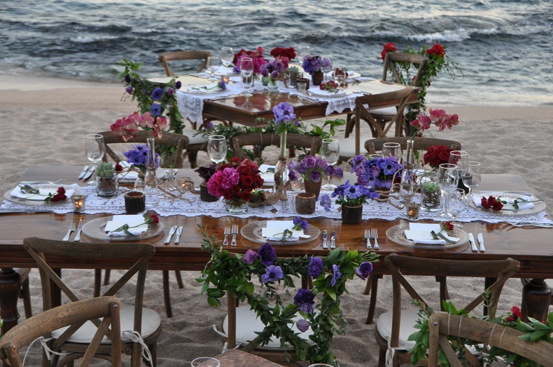red and purple flowers beach weddings mexico elena damy floral design los cabos wooden tables lace linens 15