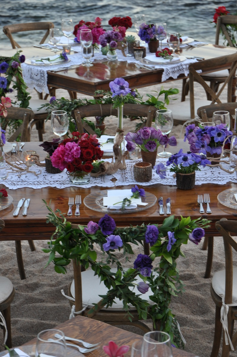 red and purple flowers beach weddings mexico elena damy floral design los cabos wooden tables lace linens 16