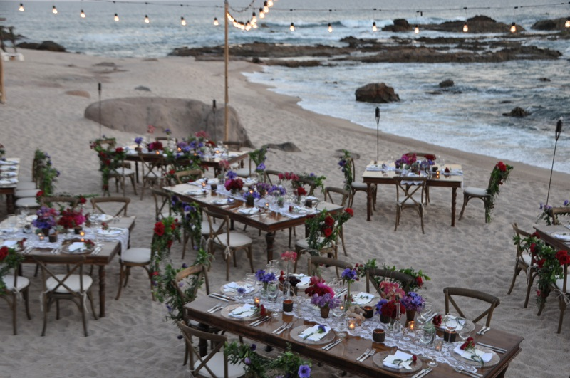 red and purple flowers beach weddings mexico elena damy floral design los cabos wooden tables lace linens 21