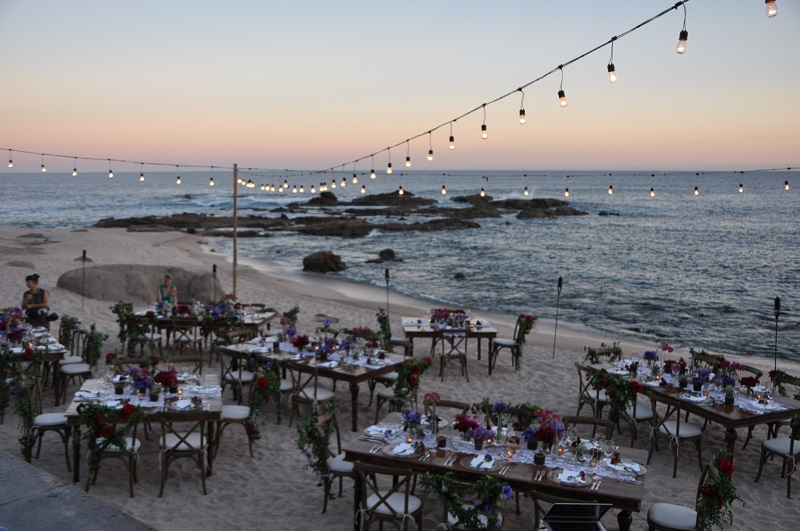 red and purple flowers beach weddings mexico elena damy floral design los cabos wooden tables lace linens 9