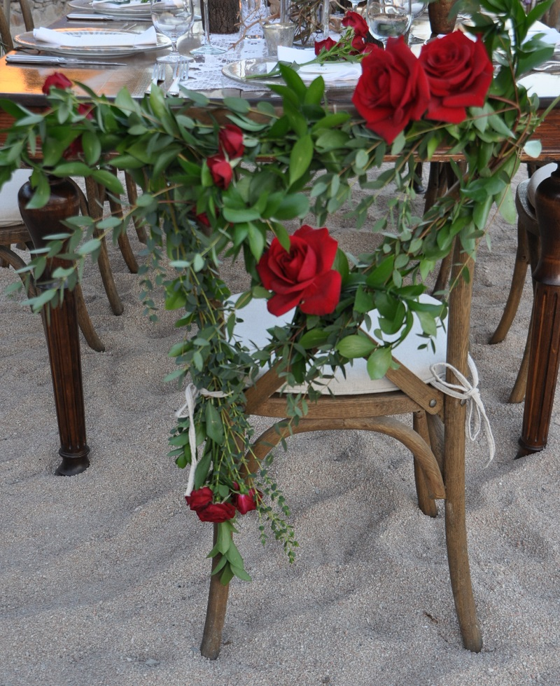 red and purple flowers beach weddings mexico elena damy floral design los cabos wooden tables lace linens red rose chairs 2
