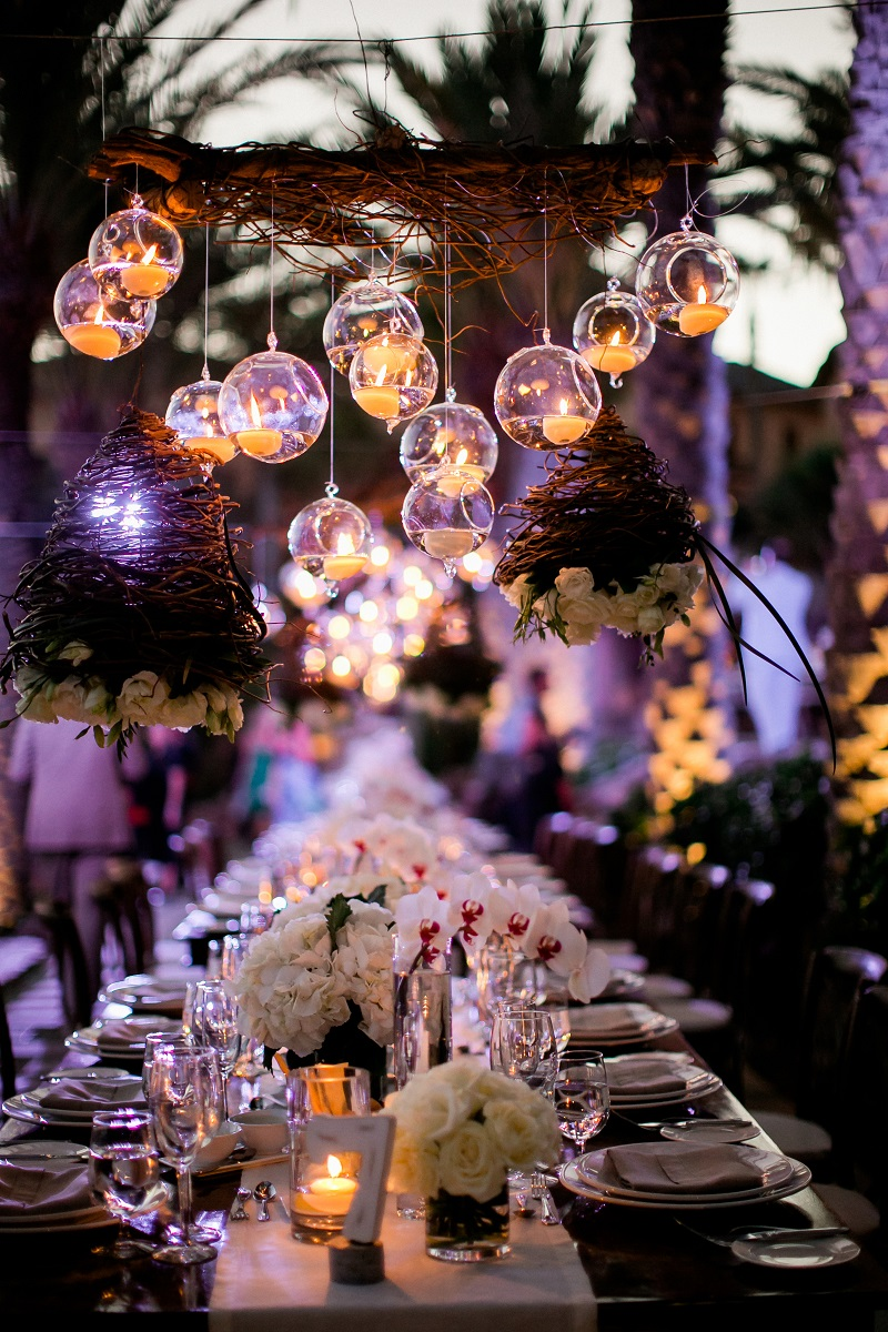 dinner reception hanging candles beach weddings los cabos esperanza resort elena damy event design chris plus lynn photography