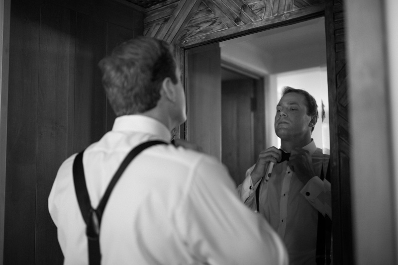 groom getting dressed beach weddings los cabos esperanza resort elena damy event design chris plus lynn photography