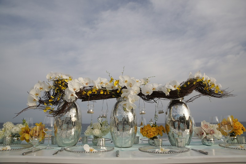 metallic vases yellow orchids beach wedding mexico elena damy chris plus lynn