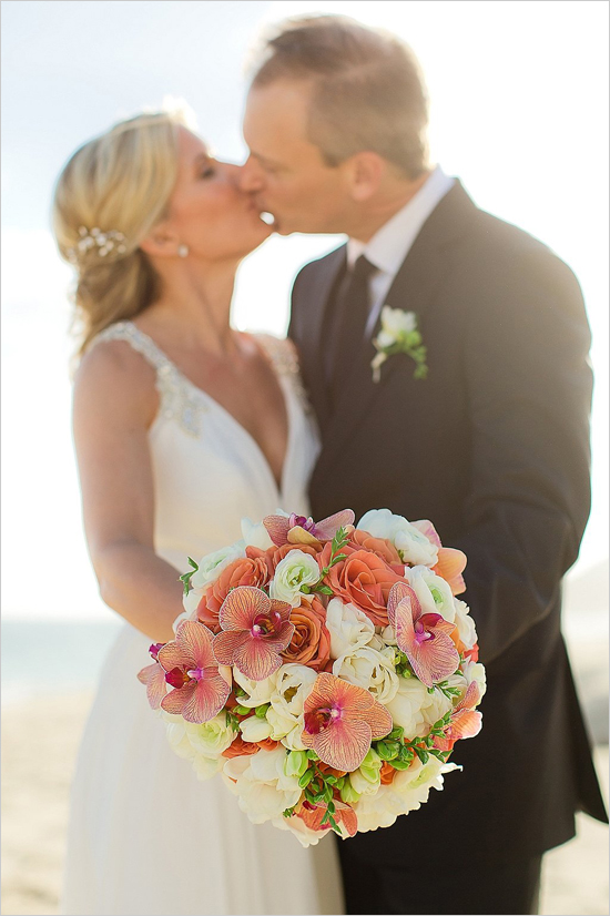 bridal bouquet with orange orchids elena damy floral design sara richardson photography cabo weddings