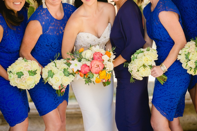 blue bridesmaids dresses tropical bridal bouquet elena damy destination weddings cabo san lucas chris plus lynn photo