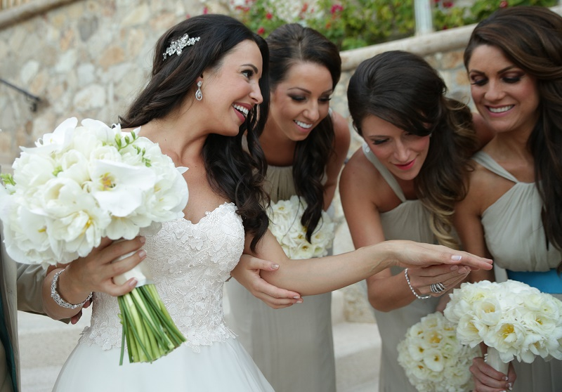 bride with bridesmaids candid photos wedding day chris plus lynn elena damy destination wedding planners mexico