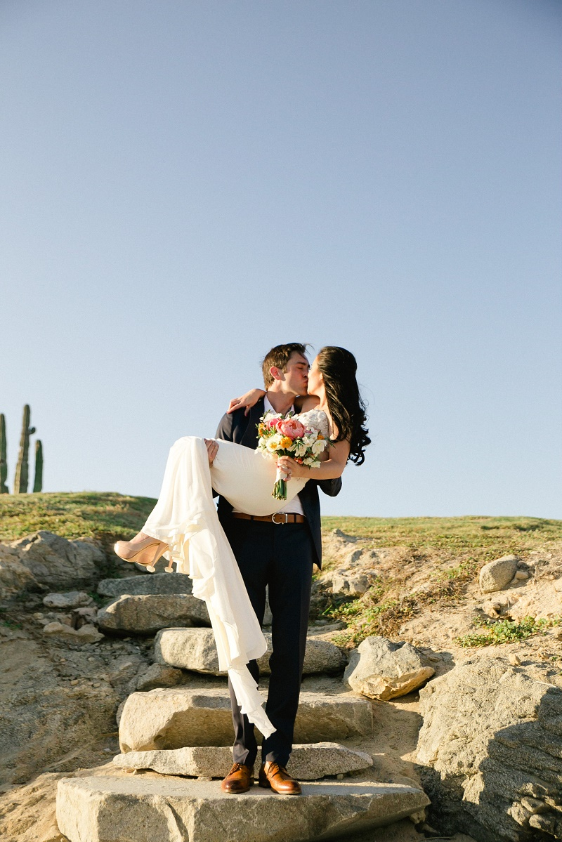 groom carrying bride weddings at cabo del sol elena damy destination wedding planners mexico chris plus lynn photo