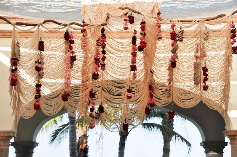 suspended macrame curtains over the dance floor elena damy event design