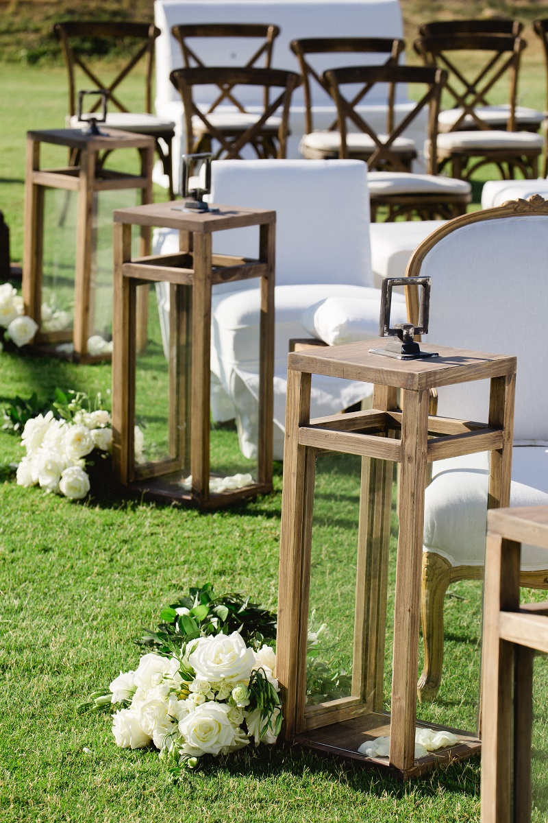 white roses wooden lanterns aisle decor weddings at cabo del sol elena damy destination wedding planners mexico chris plus lynn photo