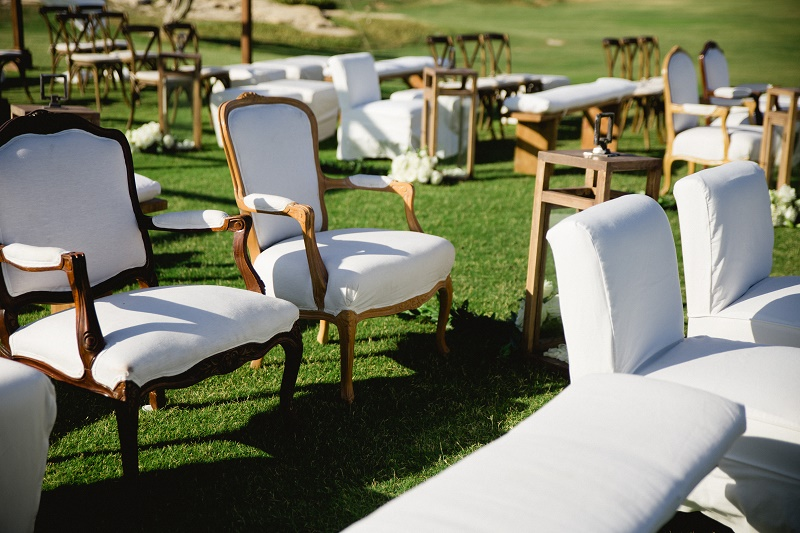 white upholstered furniture wedding ceremony weddings at cabo del sol elena damy destination wedding planners mexico chris plus lynn photo