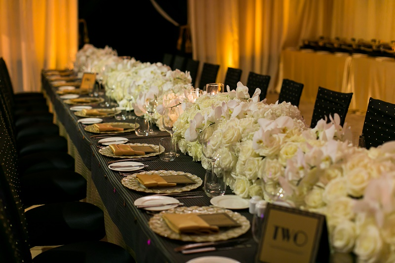 Low floral centerpieces long tables White Wedding Destination Wedding Cabo Hindu Christian Wedding Elena Damy Floral Design Ana and Jerome Photo