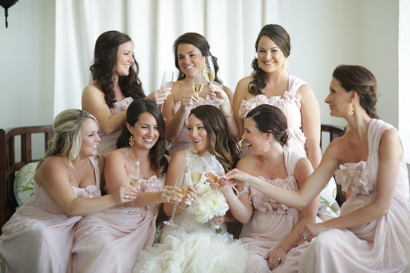 bride and bridesmaids toasting pre ceremony mexico weddings elena damy destination wedding planners