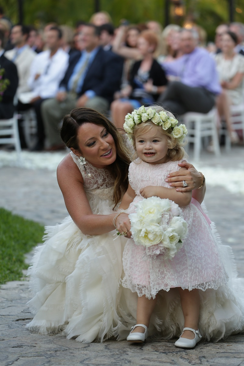 bride and flower girl Cabo Weddings One and Only Palmilla Elena Damy Event Design Cabo Chris Plus Lynn Photo