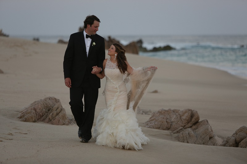 bride and groom on beach Cabo Weddings One and Only Palmilla Elena Damy Event Design Cabo Chris Plus Lynn Photo