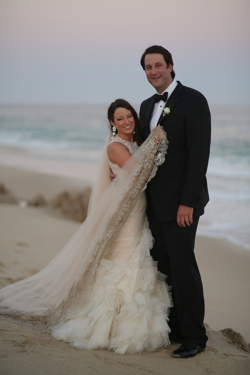 bride and groom on beach luxury weddings Cabo Weddings One and Only Palmilla Elena Damy Event Design Cabo Chris Plus Lynn Photo