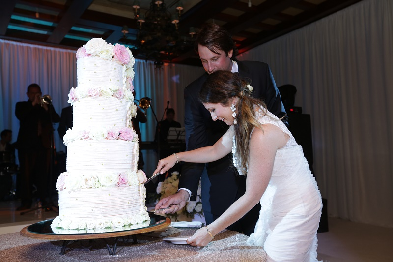 cake cutting Cabo Weddings One and Only Palmilla Elena Damy Event Design Cabo Chris Plus Lynn Photo