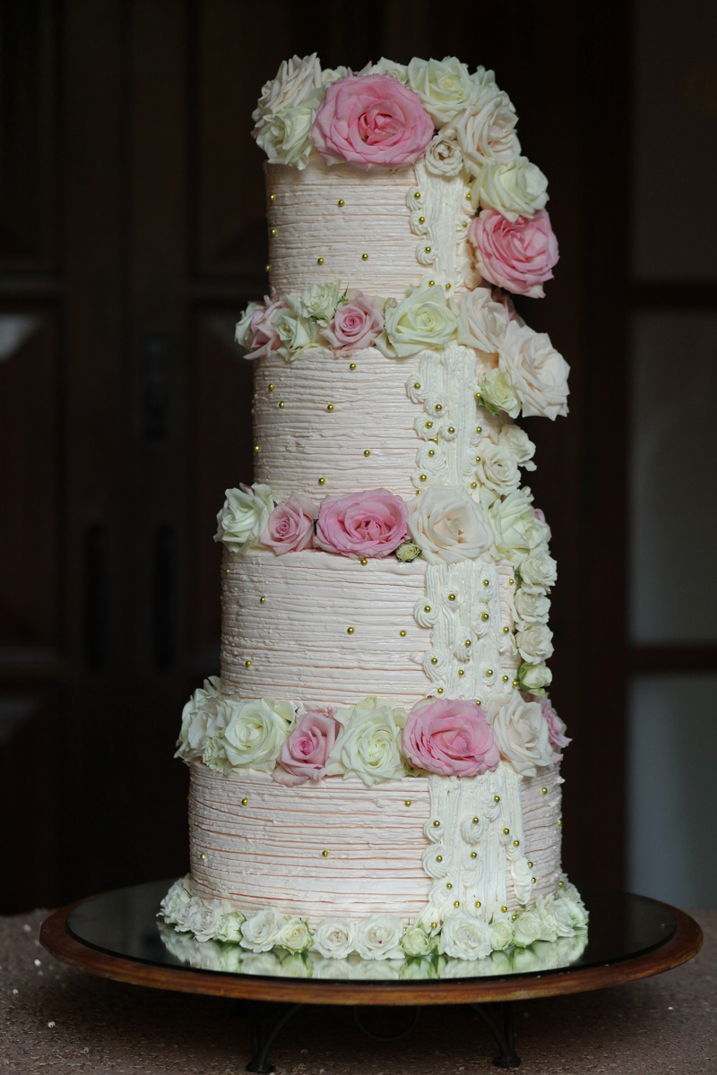 four tier stacked wedding cake Cabo Weddings One and Only Palmilla Elena Damy Event Design Cabo Chris Plus Lynn Photo