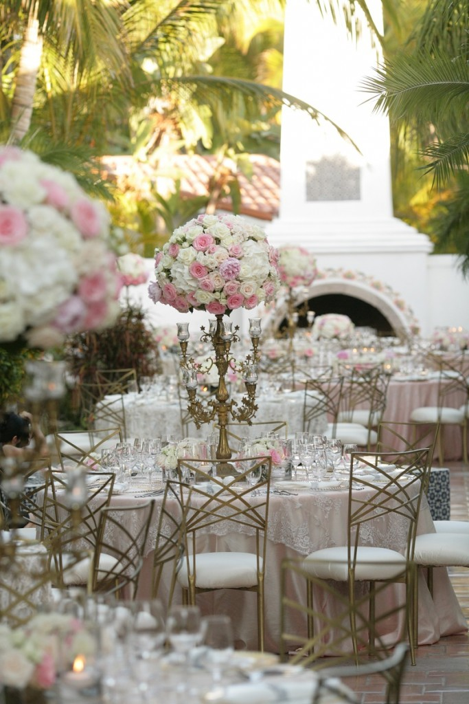 wedding reception on terraces pink flowers Cabo  Weddings One and Only Palmilla Elena Damy Event Design Cabo Chris Plus Lynn Photo