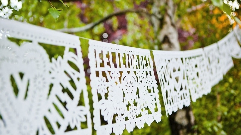 white papel picado banners mexican weddings baja weddings elena damy destination weddings