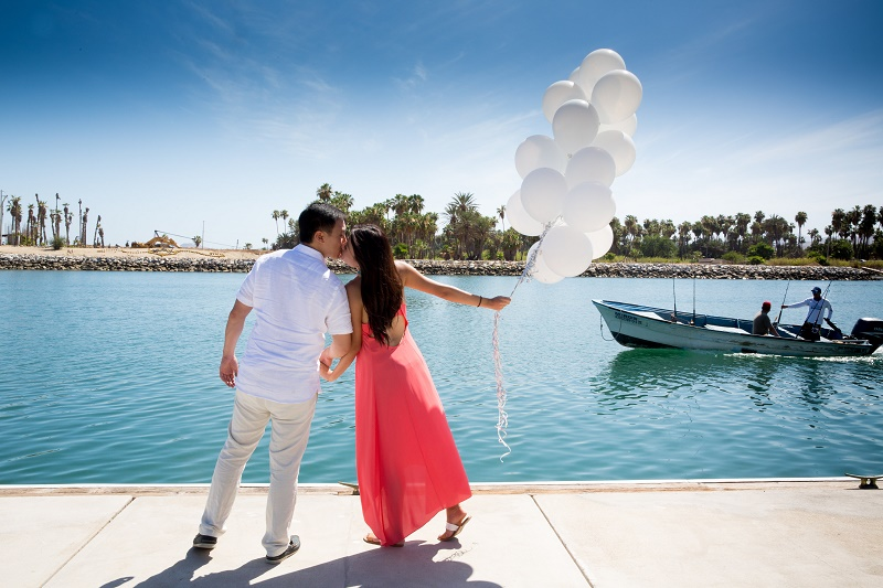 bride holding white balloons Pre Wedding Bridal Party Photo Shoots Wedding Trends 4 Eyes Photography NY Elena Damy Destination Weddings Cabo San Lucas 12
