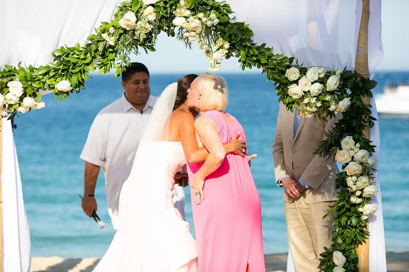 white drape and floral chuppah beach wedding cabo san lucas mexico destination weddings elena damy floral design