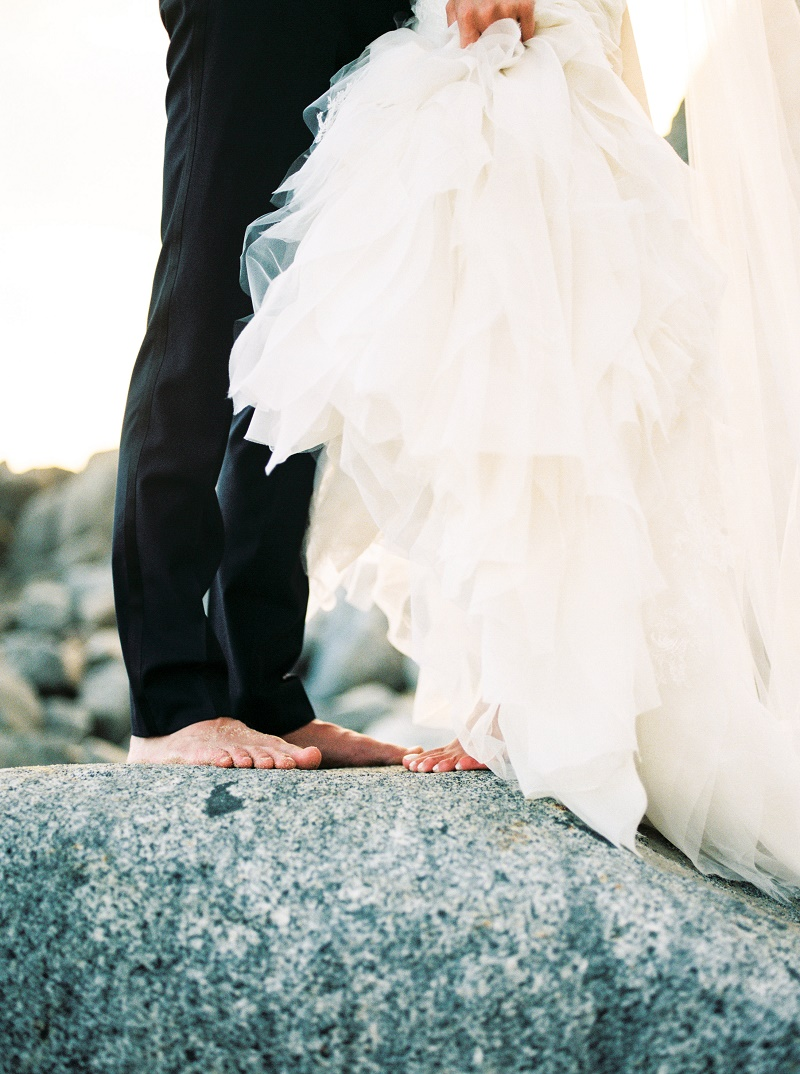 barefoot-bride-and-groom-on-the-rocks-cabo-san-lucas-weddings-elena-damy-destination-wedding-planners