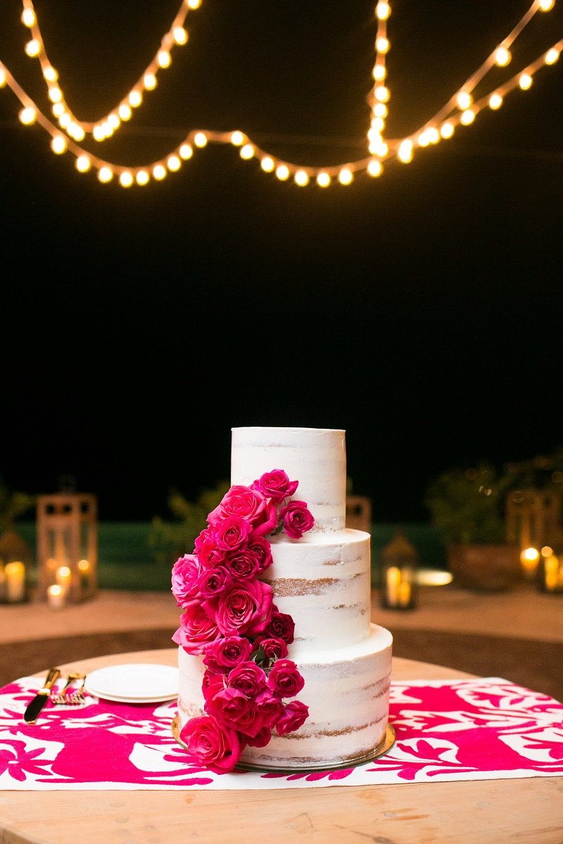 three-tier-stacked-wedding-cake-with-hot-pink-roses-cabo-weddings-casa-turquesa-los-cabos-destination-weddings