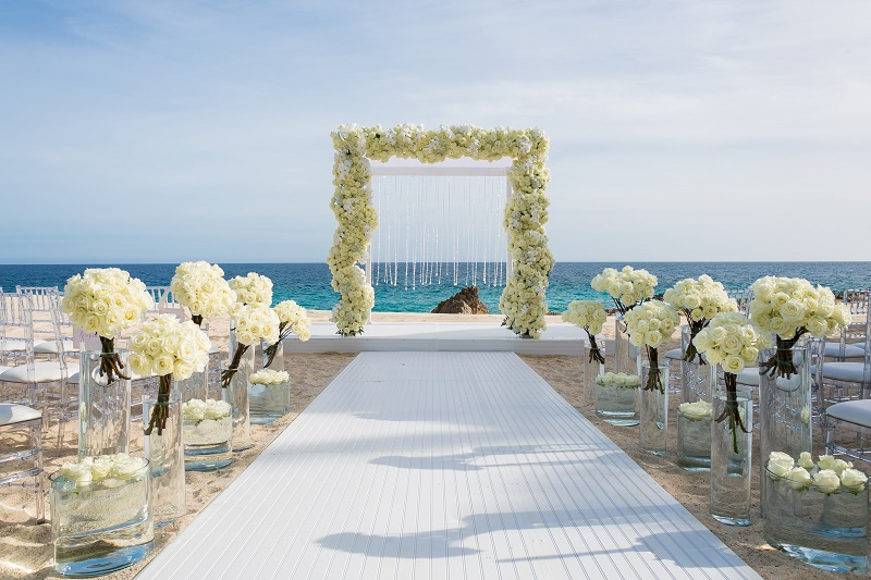 all-white-floral-arch-cabo-wedding-planners-mexico-elena-damy-destination-weddings-one-and-only-palmilla-ana-and-jerome-photo